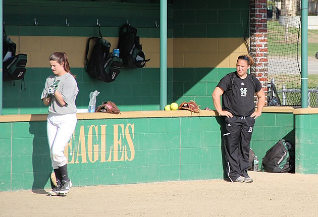 Husson University head softball coach Terren Hall looks on during a recent practice.