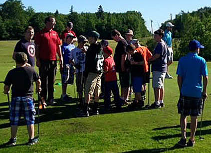 Club Pro and Owner Michael Clendenning instructs his junior golfers recently at Barnes Brook Golf Course in West Enfield, Maine.
